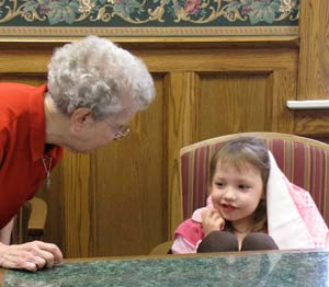 Sister Jane Guenette plays peek-a-boo with Rachel, with the pink blanket Jane gave the girl as her hiding place.